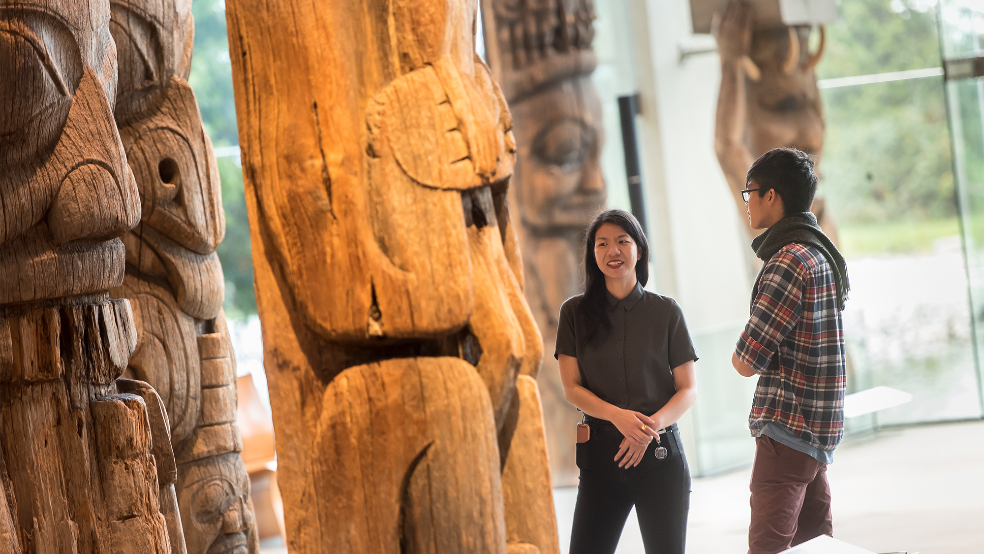 Students in discussion standing inside UBC Museum of Anthropology.